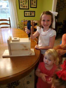 Children building bird houses
