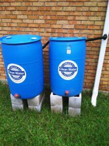 two blue rain barrels